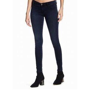 BLANK NYC black mid rise spray-on skinny jeans.